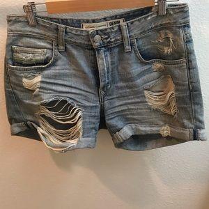 Distressed dirty looking denim jean shorts